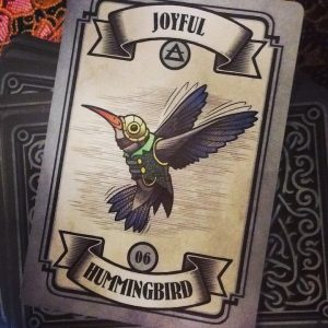 Joyful - Hummingbird card indicates joy and a lighter feeling in the heart is coming after ascension heart awakening